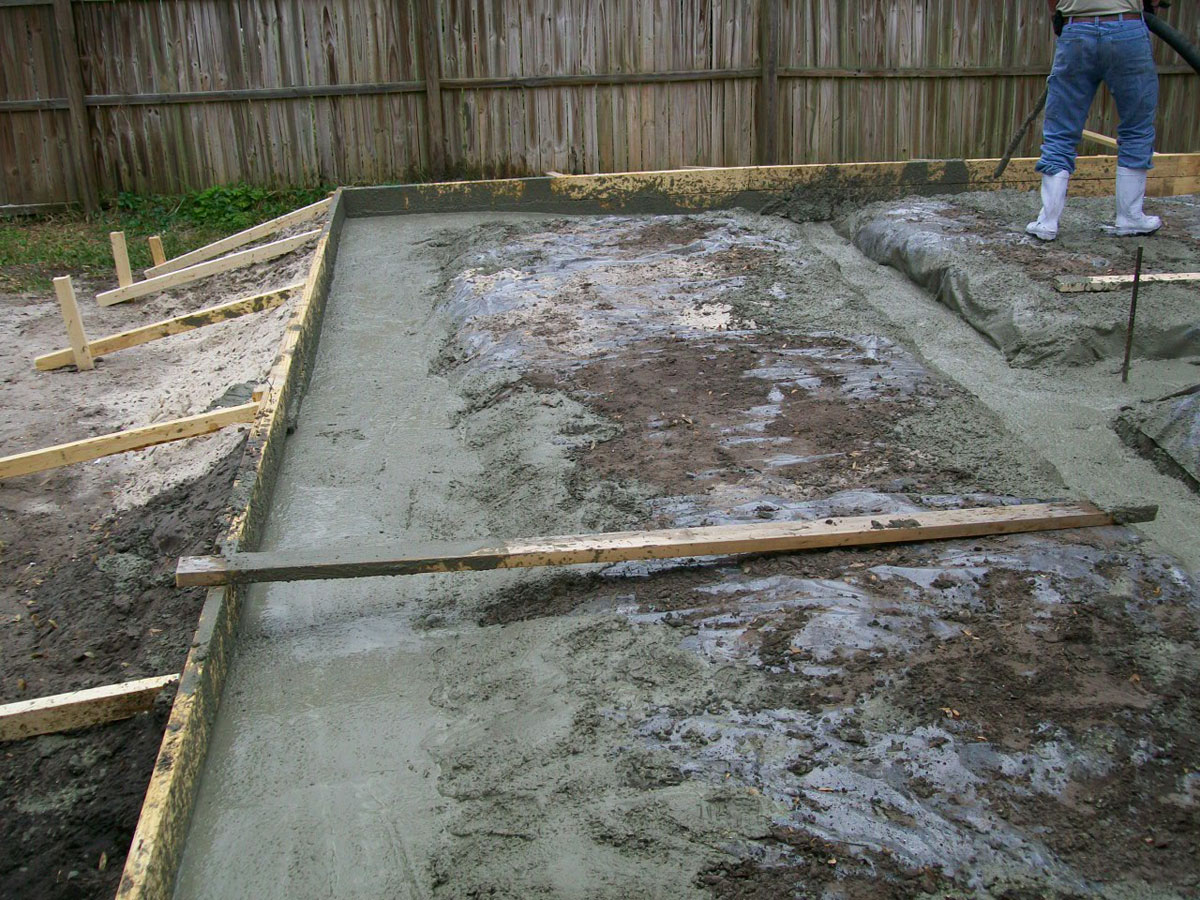 Here is the cement solidifying after our garage builders poured the concrete slab for the detached garage
