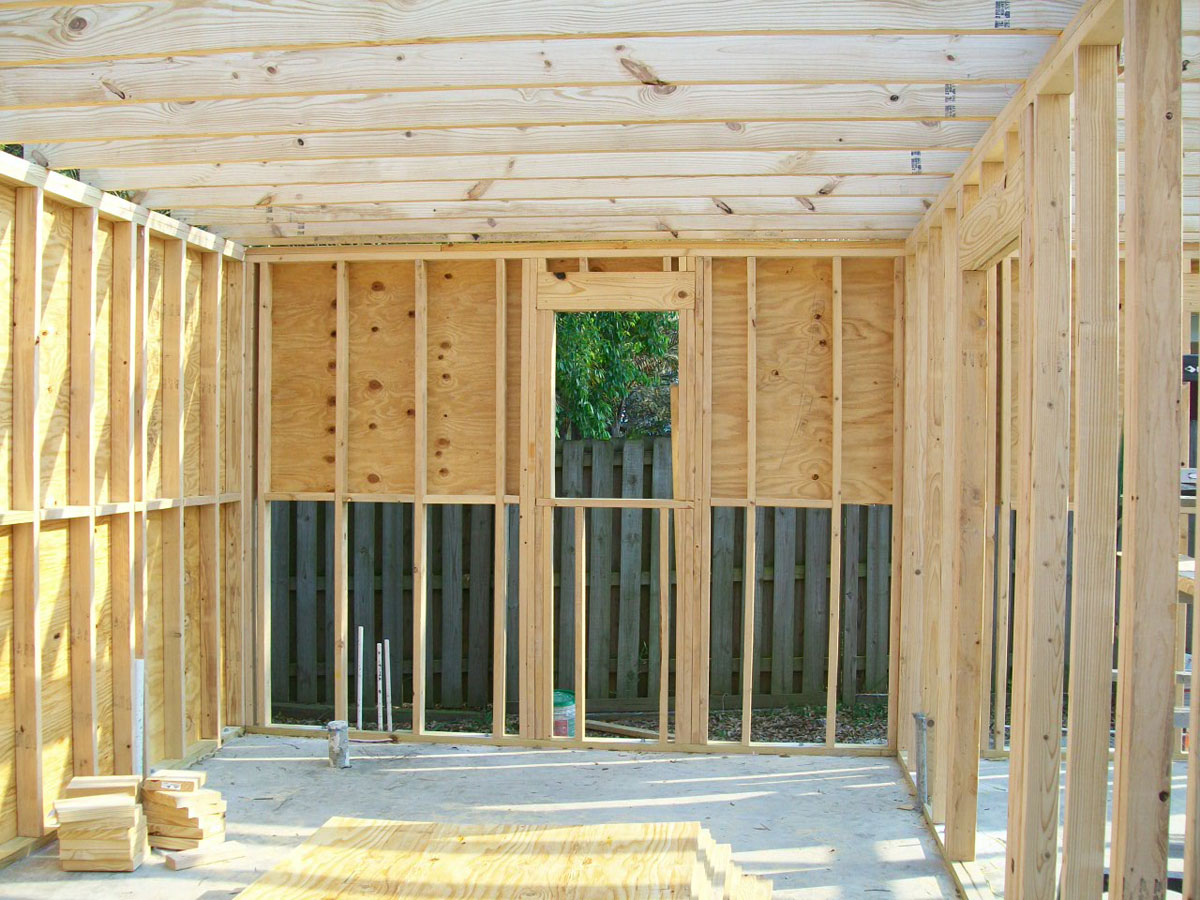 The final wall is an interior wall. With that wall, this detached addition will include two enclosed spaces. Both of the two sides of the building can be used as a one-car garage, but the home owner is also planning to use one side of the addition as a workshop and storage space.
